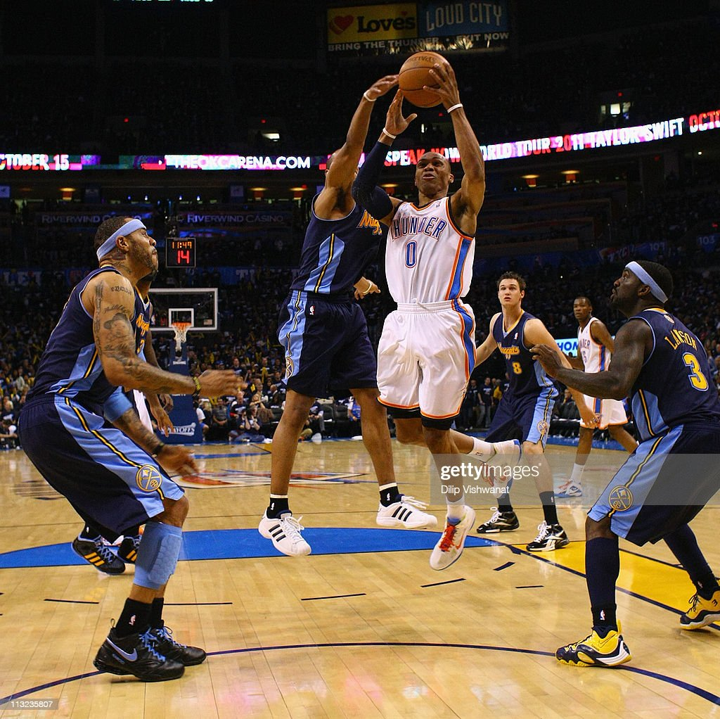 Russell Westbrook #0 of the Oklahoma City Thunder pulls down a rebound against the Denver Nuggets in Game Five of the Western Conference Quarterfinals in the 2011 NBA Playoffs on April 27, 2011 at the Ford Center in Oklahoma City, Oklahoma.