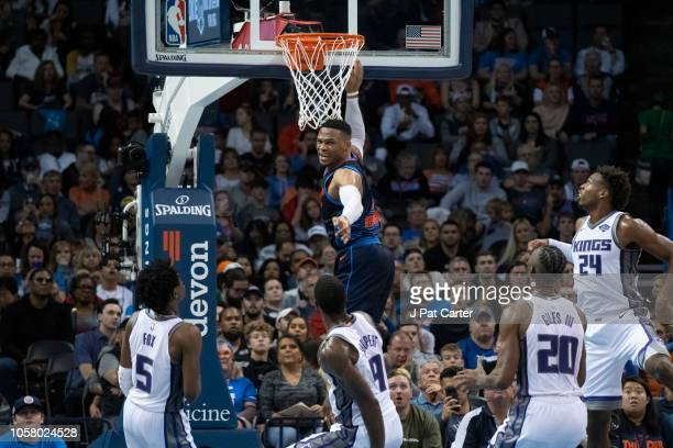 Russell Westbrook of the Oklahoma City Thunder reacts after scoring two points against the Sacramento Kings during the second half of a NBA game at...
