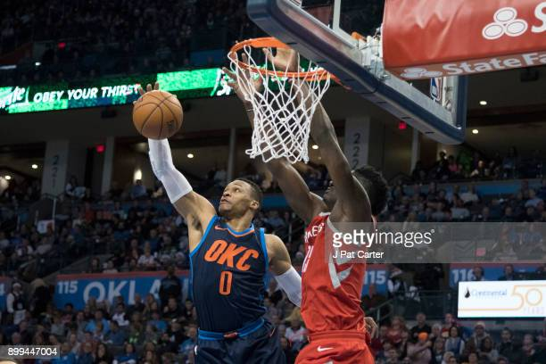 Russell Westbrook of the Oklahoma City Thunder rebounds a ball after Clint Capela of the Houston Rockets shot during the second half of a NBA game at...