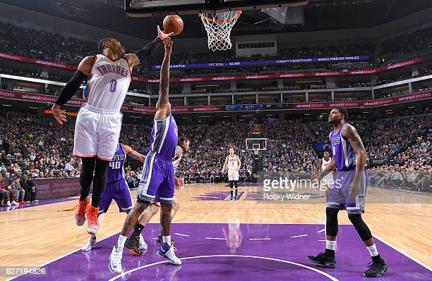 Russell Westbrook of the Oklahoma City Thunder rebounds against DeMarcus Cousins of the Sacramento Kings on November 23, 2016 at Golden 1 Center in...