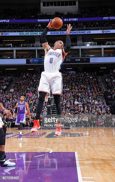 Russell Westbrook of the Oklahoma City Thunder rebounds against the Sacramento Kings on November 23 2016 at Golden 1 Center in Sacramento California...