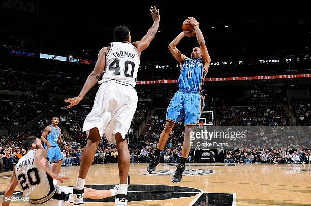 Russell Westbrook of the Oklahoma City Thunder shoots a jumper against Kurt Thomas of the San Antonio Spurs during the game on December 14 2008 at...