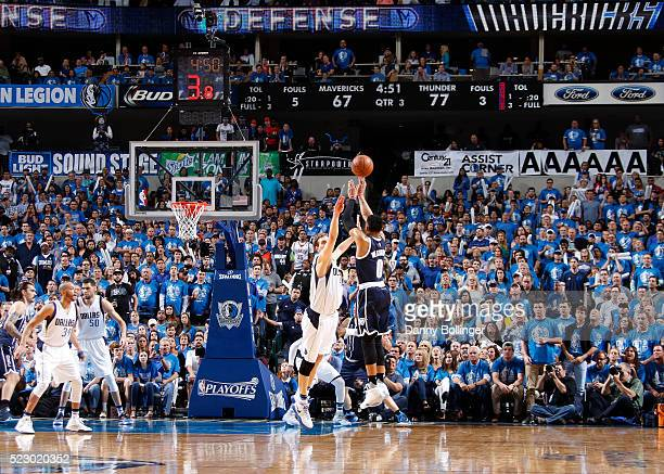 Russell Westbrook of the Oklahoma City Thunder shoots a lateclock three against the Dallas Mavericks in Game Three of the Western Conference...