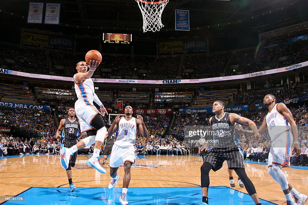 Russell Westbrook #0 of the Oklahoma City Thunder shoots a layup against the Orlando Magic on March 15, 2013 at the Chesapeake Energy Arena in Oklahoma City, Oklahoma.