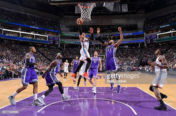 Russell Westbrook of the Oklahoma City Thunder shoots a layup against Garrett Temple of the Sacramento Kings on November 23 2016 at Golden 1 Center...