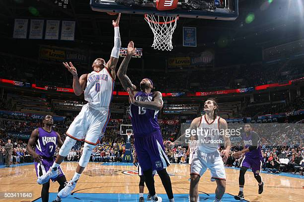 Russell Westbrook of the Oklahoma City Thunder shoots a layup during the game against the Sacramento Kings on January 4 2016 at Chesapeake Energy...