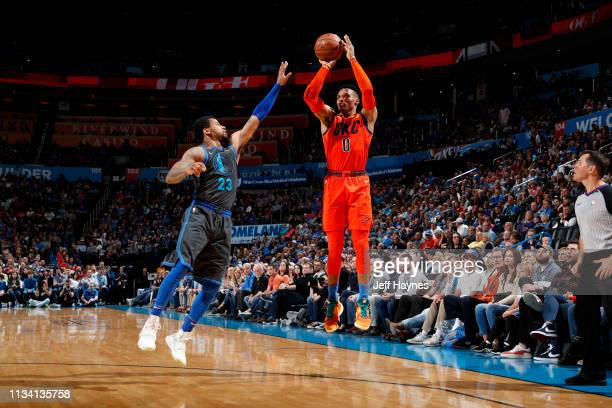 Russell Westbrook of the Oklahoma City Thunder shoots a three point basket against the Dallas Mavericks on March 31 2019 at Chesapeake Energy Arena...