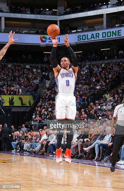 Russell Westbrook of the Oklahoma City Thunder shoots a three pointer against the Sacramento Kings on November 23 2016 at Golden 1 Center in...
