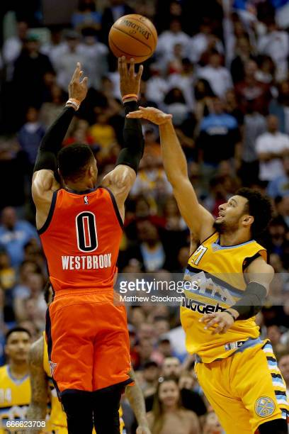 Russell Westbrook of the Oklahoma City Thunder shoots a threepoint shot at the buzzer against Jamal Murray of the Denver Nuggets at Pepsi Center on...