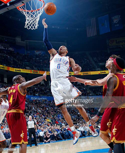 Russell Westbrook of the Oklahoma City Thunder shoots against Antawn Jamison of the Cleveland Cavaliers on December 12 2010 at the Ford Center in...