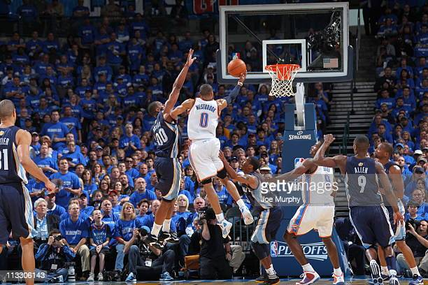 Russell Westbrook of the Oklahoma City Thunder shoots against Darrell Arthur of the Memphis Grizzlies in Game One of the Western Conference...