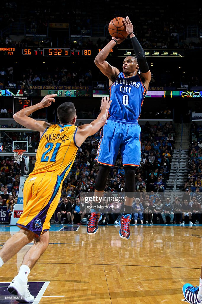 Russell Westbrook #0 of the Oklahoma City Thunder shoots against Greivis Vasquez #21 of the New Orleans Hornets on November 16, 2012 at the New Orleans Arena in New Orleans, Louisiana.
