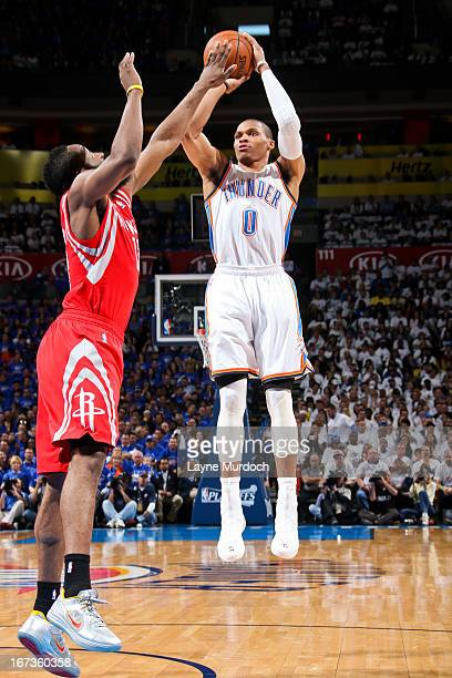 Russell Westbrook of the Oklahoma City Thunder shoots against James Harden of the Houston Rockets in Game Two of the Western Conference Quarterfinals...
