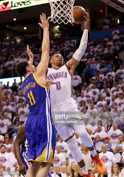 Russell Westbrook of the Oklahoma City Thunder shoots against Klay Thompson of the Golden State Warriors in the third quarter in game four of the...