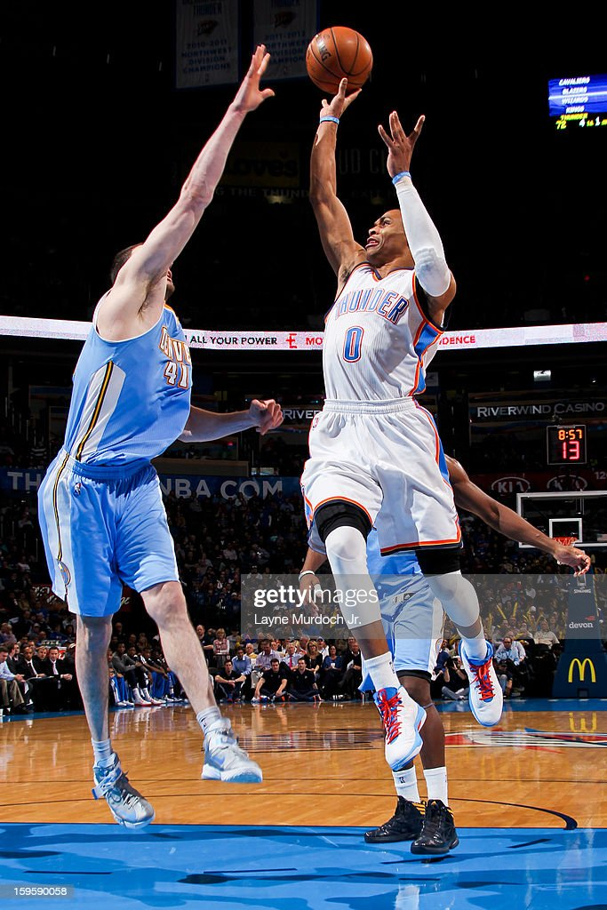 Russell Westbrook #0 of the Oklahoma City Thunder shoots against Kosta Koufos #41 of the Denver Nuggets on January 16, 2013 at the Chesapeake Energy Arena in Oklahoma City, Oklahoma.