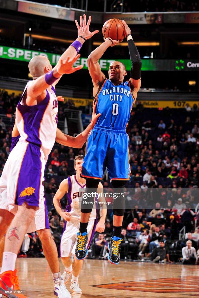 Russell Westbrook #0 of the Oklahoma City Thunder shoots against Marcin Gortat #4 of the Phoenix Suns on January 14, 2013 at U.S. Airways Center in Phoenix, Arizona.