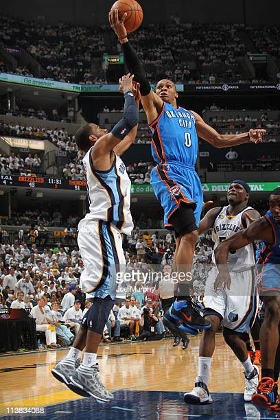 Russell Westbrook of the Oklahoma City Thunder shoots against Mike Conley of the Memphis Grizzlies in Game Three of the Western Conference Semifinals...