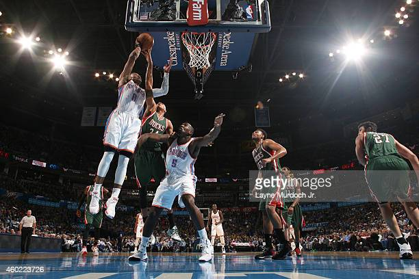 Russell Westbrook of the Oklahoma City Thunder shoots against the Milwaukee Bucks on December 9 2014 at Chesapeake Energy Arena in Oklahoma City OK...