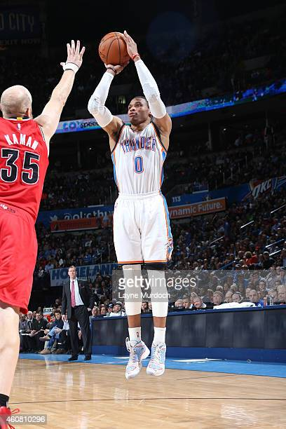 Russell Westbrook of the Oklahoma City Thunder shoots against the Portland Trail Blazers on December 23 2014 at Chesapeake Energy Arena in Oklahoma...