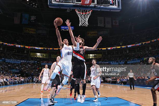 Russell Westbrook of the Oklahoma City Thunder shoots against the Portland Trail Blazers on April 13 2015 at Chesapeake Energy Arena in Oklahoma City...