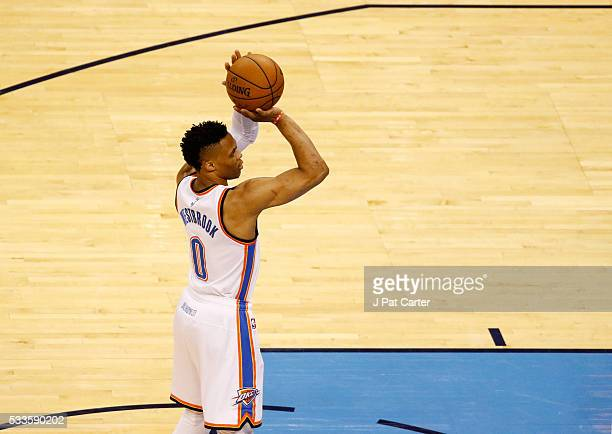 Russell Westbrook of the Oklahoma City Thunder shoots against the Golden State Warriors in the first quater in game three of the Western Conference...