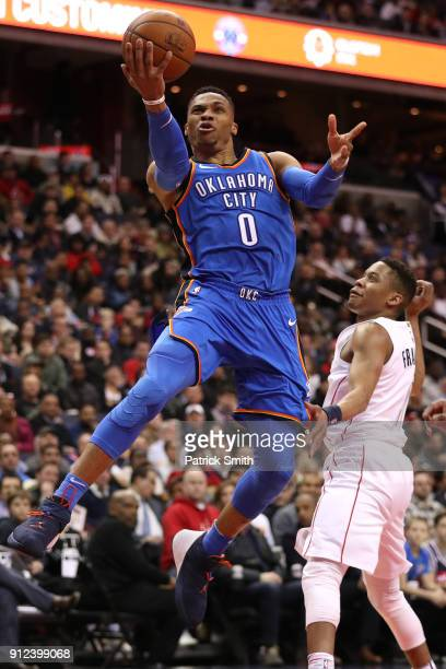 Russell Westbrook of the Oklahoma City Thunder shoots in front of Tim Frazier of the Washington Wizards during the first half at Capital One Arena on...