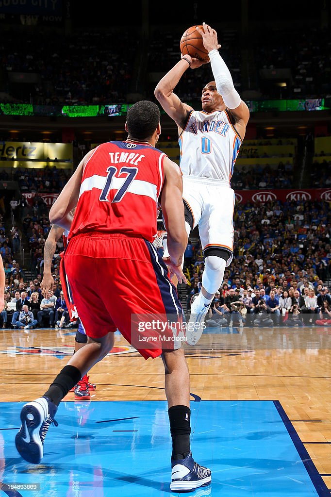Russell Westbrook #0 of the Oklahoma City Thunder shoots in the lane against Garrett Temple #17 of the Washington Wizards on March 27, 2013 at the Chesapeake Energy Arena in Oklahoma City, Oklahoma.