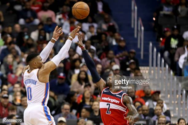 Russell Westbrook of the Oklahoma City Thunder shoots over John Wall of the Washington Wizards during the second half at Capital One Arena on...