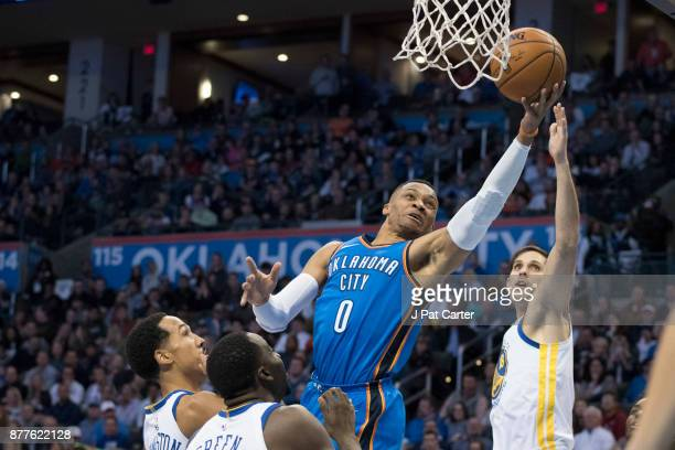 Russell Westbrook of the Oklahoma City Thunder shoots over Omri Casspi of the Golden State Warriors during the first half of a NBA game at the...