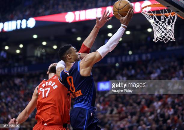 Russell Westbrook of the Oklahoma City Thunder shoots the ball as Jonas Valanciunas of the Toronto Raptors defends during the first half of an NBA...