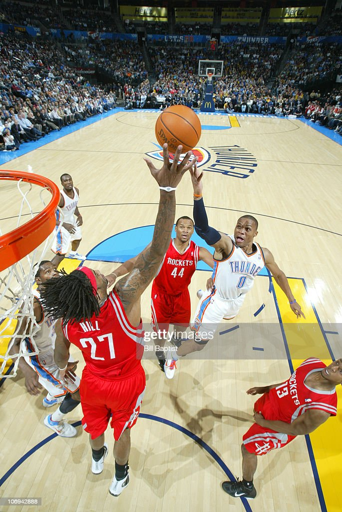 Russell Westbrook #0 of the Oklahoma City Thunder shoots the ball against Jordan Hill #27 of the Houston Rockets on November 17, 2010 at the Oklahoma City Arena in Oklahoma City, Oklahoma.