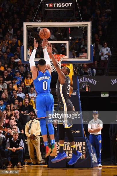 Russell Westbrook of the Oklahoma City Thunder shoots the ball against Kevin Durant of the Golden State Warriors on February 6 2018 at ORACLE Arena...