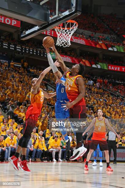 Russell Westbrook of the Oklahoma City Thunder shoots the ball against Donovan Mitchell of the Utah Jazz in Game Three of Round One of the 2018 NBA...