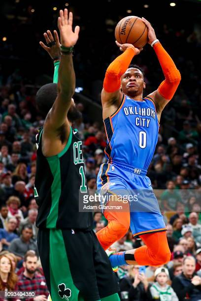 Russell Westbrook of the Oklahoma City Thunder shoots the ball over Kyrie Irving of the Boston Celtics during a game at TD Garden on February 3 2019...