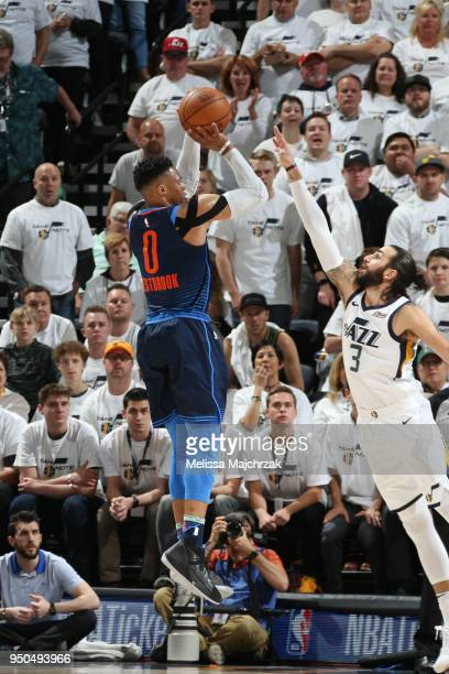 Russell Westbrook of the Oklahoma City Thunder shoots the ball against Ricky Rubio of the Utah Jazz in Game Four of Round One of the 2018 NBA...