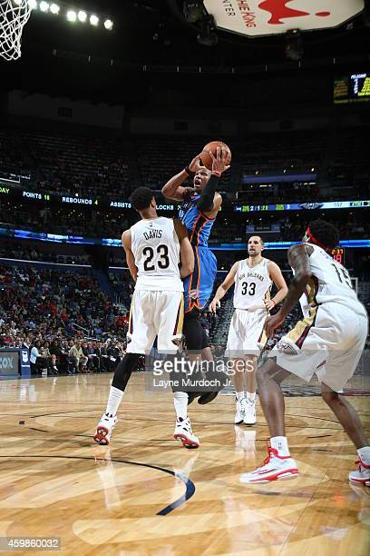 Russell Westbrook of the Oklahoma City Thunder shoots the ball against the New Orleans Pelicans during the game on December 2 2014 at the Smoothie...