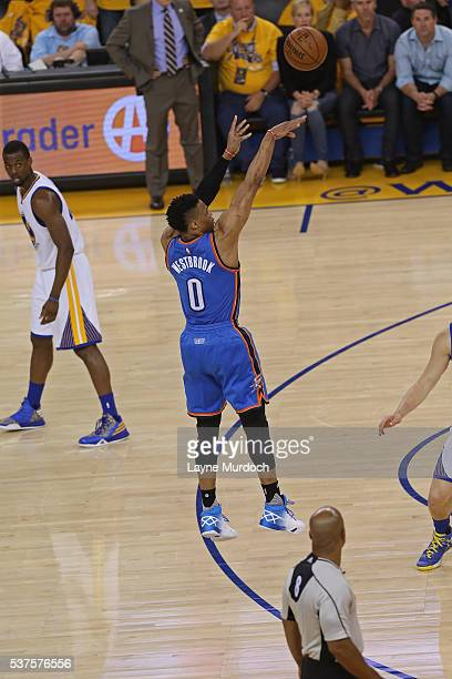 Russell Westbrook of the Oklahoma City Thunder shoots the ball against the Golden State Warriors in Game Five of the Western Conference Finals during...