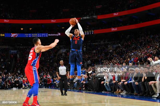 Russell Westbrook of the Oklahoma City Thunder shoots the ball against the Philadelphia 76ers at Wells Fargo Center on December 15 2017 in...
