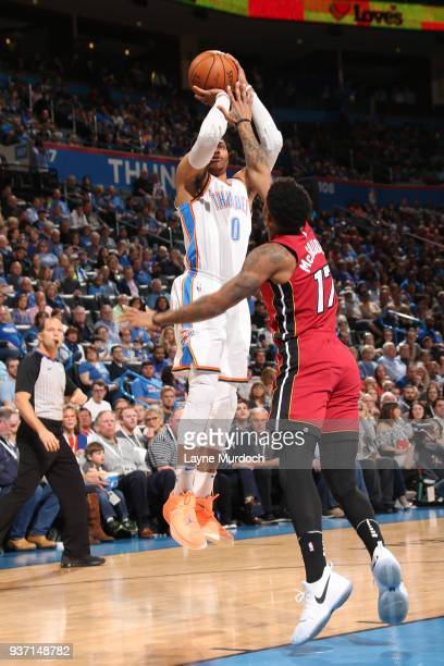 Russell Westbrook of the Oklahoma City Thunder shoots the ball against the Miami Heat on March 23 2018 at Chesapeake Energy Arena in Oklahoma City...