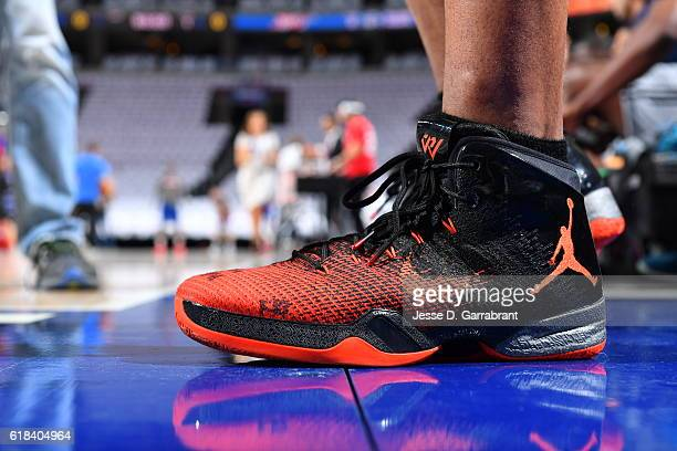 Russell Westbrook of the Oklahoma City Thunder showcases his Nike Jordan sneakers prior to the game against Philadelphia 76ers during game at the...