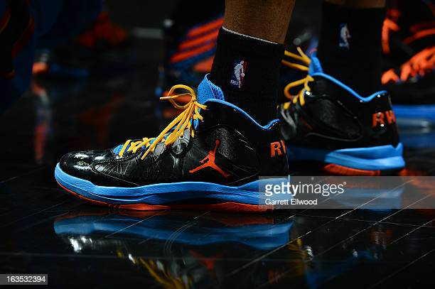 Russell Westbrook of the Oklahoma City Thunder shows off his sneakers during the game against the San Antonio Spurs on March 11 2013 at the ATT...
