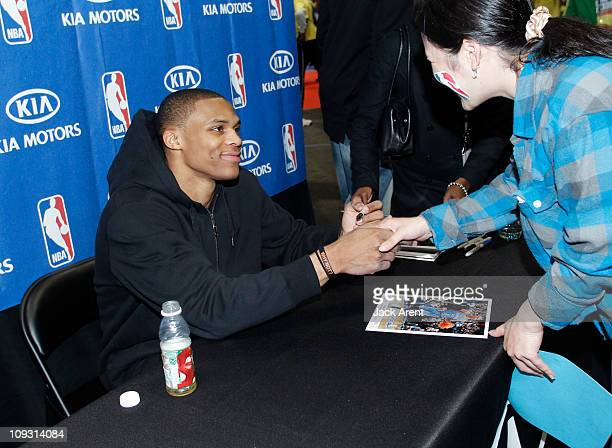 Russell Westbrook of the Oklahoma City Thunder signs autographs at the Kia court during Jam Session presented by Adidas during All Star Weekend on...