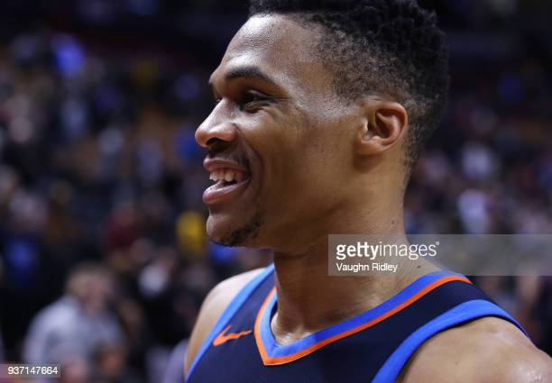 Russell Westbrook of the Oklahoma City Thunder smiles after defeating the Toronto Raptors in an NBA game at Air Canada Centre on March 18 2018 in...