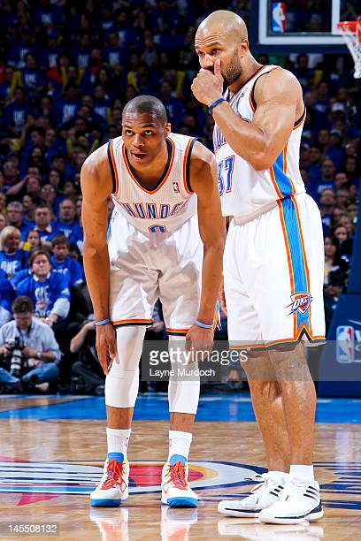 Russell Westbrook of the Oklahoma City Thunder speaks to teammate Derek Fisher while playing against the San Antonio Spurs in Game Three of the...