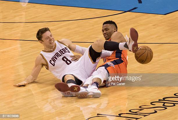 Russell Westbrook of the Oklahoma City Thunder steals the ball from Matthew Dellavedova of the Cleveland Cavaliers during the fourth quarter of a NBA...