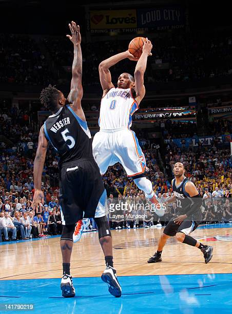 Russell Westbrook of the Oklahoma City Thunder takes a jumper against Martell Webster of the Minnesota Timberwolves on March 23 2012 at the...
