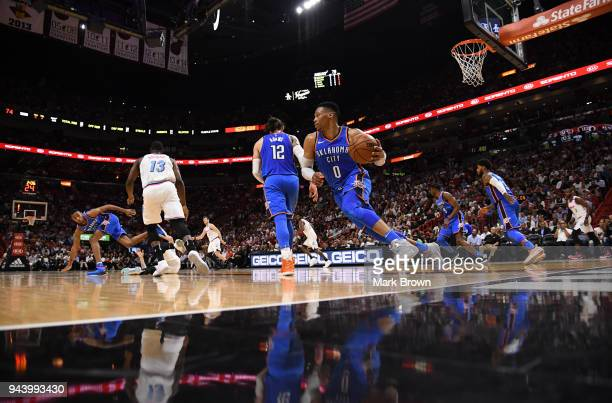 Russell Westbrook of the Oklahoma City Thunder takes the ball up the court after rebounding during the game against Miami Heat at American Airlines...