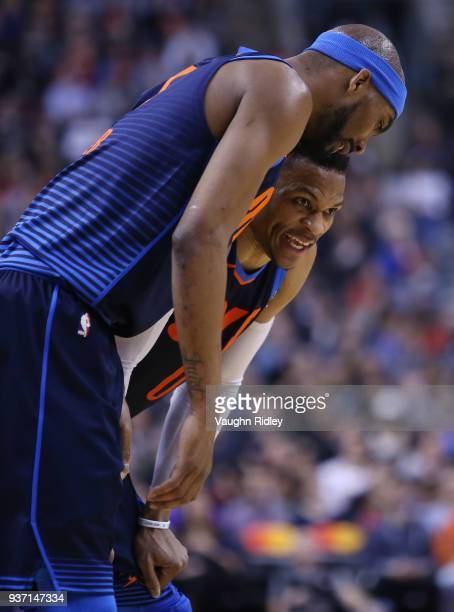 Russell Westbrook of the Oklahoma City Thunder talks to Corey Brewer during the first half of an NBA game against the Toronto Raptors at Air Canada...