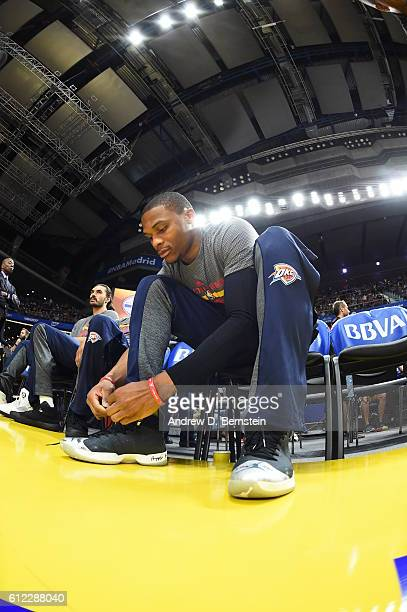 Russell Westbrook of the Oklahoma City Thunder ties his shoes prior to the game against Real Madrid as part of the 2016 Global Games on October 3...