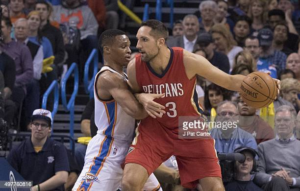 Russell Westbrook of the Oklahoma City Thunder tries to block Ryan Anderson of the New Orleans Pelicans during the first quarter of a NBA game at the...